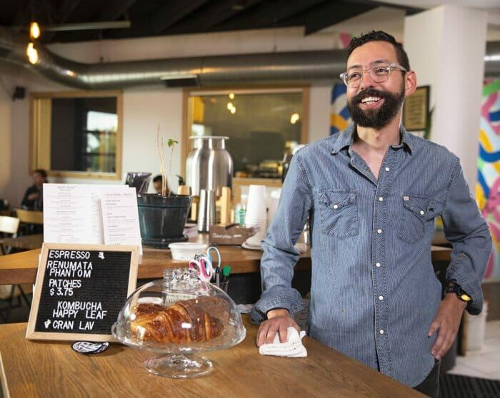 Huckleberry Roasters employee works with Gusto