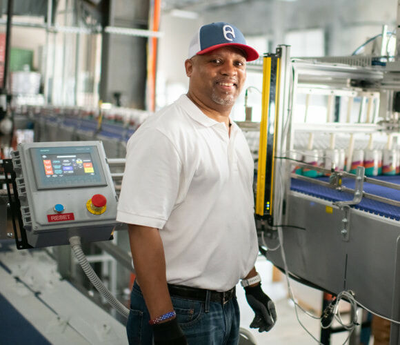 American Canning employee works with Gusto